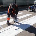 В Люберцах, несмотря на конец октября, ремонтируют дороги и наносят разметку
