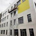 Строители приступили к монтажу фасада в новом корпусе школы №59 в Люберцах
